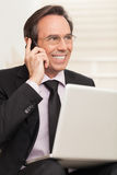 Happy business man speaking on cellphone while at stairs Royalty Free Stock Photo