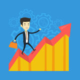 Happy business man standing on profit chart. Stock Image
