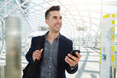 Happy business man in station with mobile phone Royalty Free Stock Images