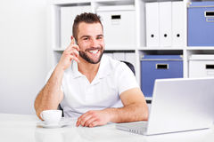 Happy business man talking on the phone royalty free stock photography
