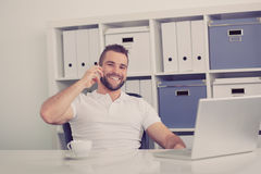Happy business man talking on the phone, toned Stock Photos