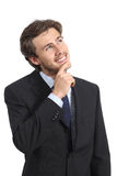 Happy business man thinking and looking at side Stock Images