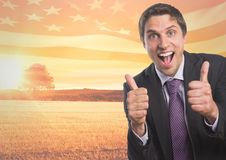 Happy business man with thumbs up against sunset landscape. Digital composite of Happy business man with thumbs up against sunset landscape royalty free stock images
