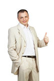 Happy business man with thumbs up gesture. Happy smiling young business man with thumbs up gesture stock images