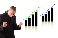Happy business man with two rising graphs Royalty Free Stock Image