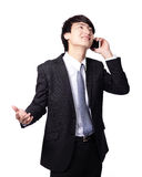 Happy business man using mobile phone. Happy handsome young business man using mobile phone isolated on white background, model is a asian male Royalty Free Stock Photography
