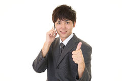 Happy business man using mobile phone. Portrait of an Asian businessman Stock Photos