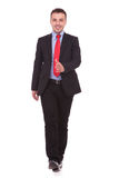 Happy business man walking on white studio background Royalty Free Stock Image