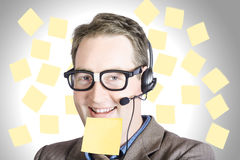 Happy business man wearing helpdesk headset Stock Images