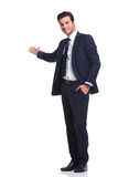 Happy business man welcoming you Royalty Free Stock Photo