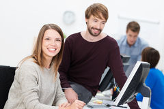 Happy business man and woman working together Stock Photo