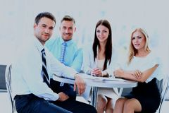 Happy business man with colleagues at a conference in the background. Royalty Free Stock Images