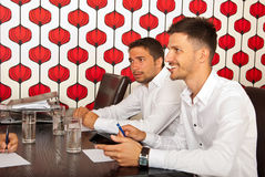 Happy business men at meeting Royalty Free Stock Photo