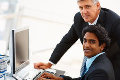 Happy business men working on a computer Royalty Free Stock Images