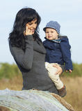 Happy business mother with little boy Stock Photos