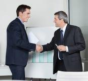 Happy business partner shaking stock image