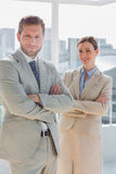 Happy business partners with arms crossed Royalty Free Stock Image