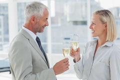 Happy business partners celebrating with champagne Stock Photo