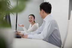 Happy business partners discussing in the office Stock Photos