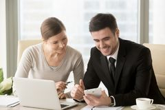 Happy business partners sorting out startup ideas stock images