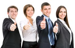 Happy business people. Group of happy business people giving the thumbs-up sign Stock Photo