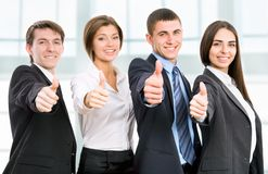 Happy business people. Group of happy business people giving the thumbs-up sign Royalty Free Stock Photo