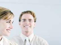 Happy business people. Business woman and man smiling and happy Royalty Free Stock Photos