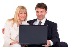 Happy business people. Half body portrait of woman and middle aged businesspeople looking at laptop, isolated on Stock Photos