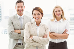Happy business people with arms crossed in office Royalty Free Stock Photography