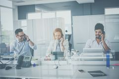 Free Happy Business People At His Office. Royalty Free Stock Photography - 125509117