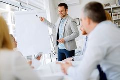 Happy business people in office stock image