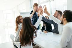 Happy business people celebrating success stock photography