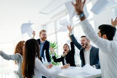 Happy business people celebrating success. At company royalty free stock image