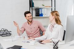 happy business people chatting at workplace stock image