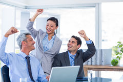 Happy business people cheering together Royalty Free Stock Photography