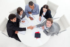 Happy business people closing a deal Royalty Free Stock Photo