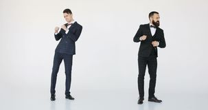 Two happy caucasian business man dancing. young successful professionals white background