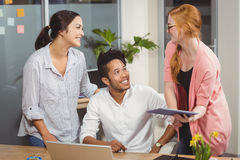 Happy business people at desk Stock Photography
