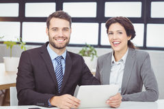 Happy business people with digital tablet in office Stock Photography