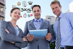 Happy business people with digital tablet and social media icons Royalty Free Stock Photos