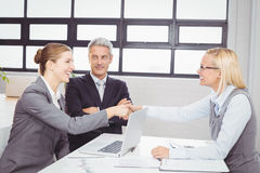 Happy business people handshaking with client Royalty Free Stock Images