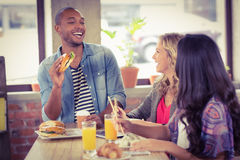 Happy business people having breakfast. In bright creative office stock photos