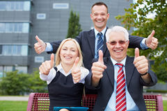 Happy business people holding Royalty Free Stock Photography