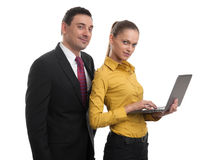 Happy business people with laptop Stock Photography