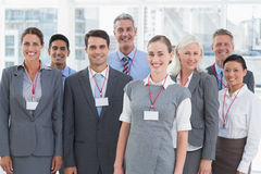 Happy business people looking at camera Royalty Free Stock Photos