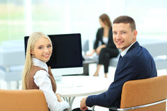 Happy business people looking at camera in office Stock Photography