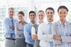 Happy business people looking at camera in a row Stock Images