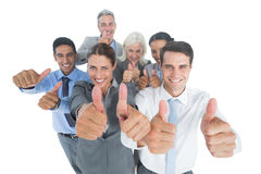Happy business people looking at camera with thumbs up Stock Photography