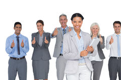 Happy business people looking at camera with thumbs up Stock Images