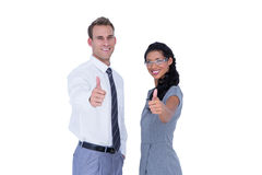 Happy business people looking at camera with thumbs up Royalty Free Stock Images
